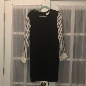 Black dress with white and blue striped sleeves